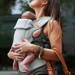 mum wearing newborn in beco gemini baby carrier french dot design