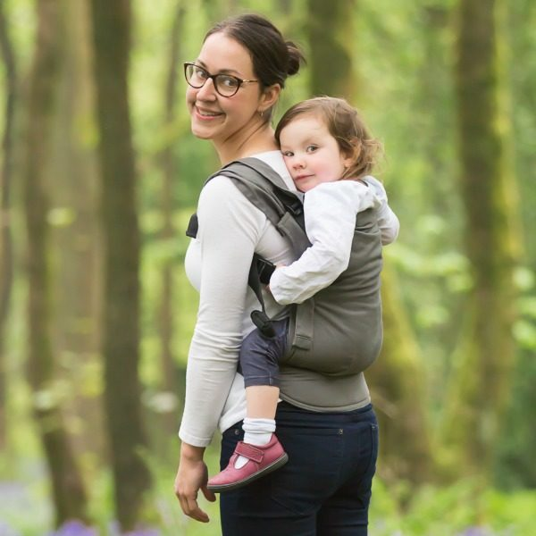 Izmi Toddler Carrier being used by mum to back carry her child