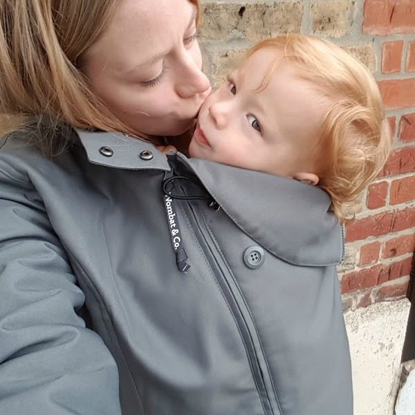 mother with toddler inside wombt babywearing coats