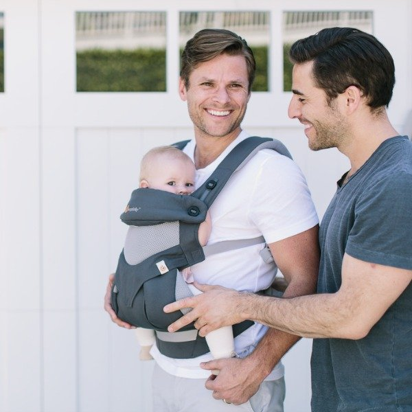 Two Dads carrying their baby in an ERGOBABY 360 COOL AIR BABY CARRIER